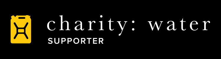 horizontal charity: water logo on black